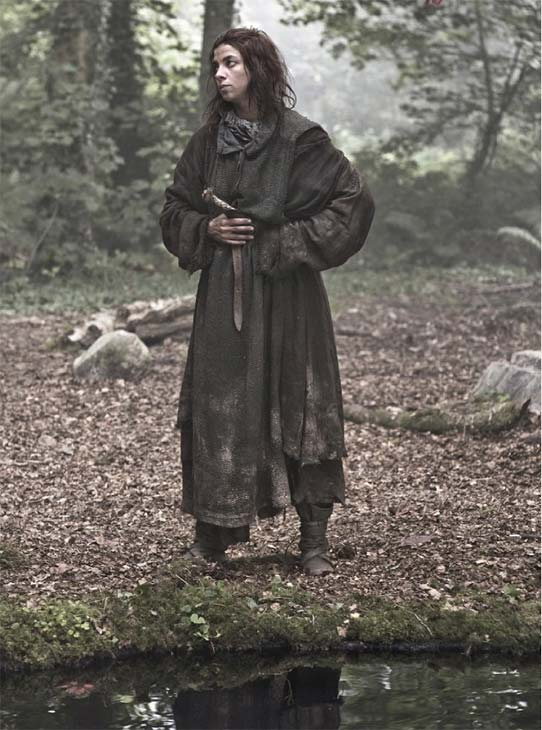 "<div class=""meta ""><span class=""caption-text "">Natalia Tena appears as Osha in a scene from season 3 of the HBO show 'Game of Thrones.' (Helen Sloan / HBO)</span></div>"