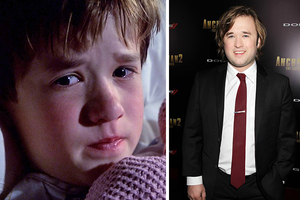 Haley Joel Osment appears in a scene from the 1999 film 'The Sixth Sense.' / Haley Joel Osment attends the premiere of 'Anchorman 2: The Legend Continues' in New York on Dec. 15 ,2013.
