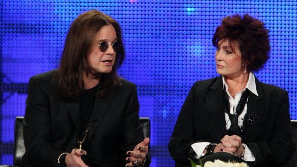 Ozzy Osbourne appears next to his wife Sharon in...