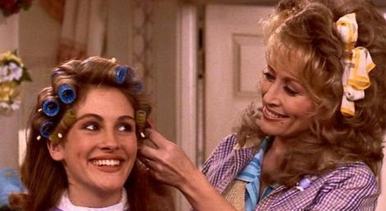 Dolly Parton and Julia Roberts appear in a scene...