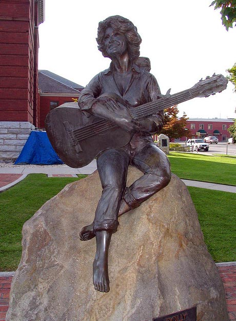 "<div class=""meta image-caption""><div class=""origin-logo origin-image ""><span></span></div><span class=""caption-text"">In 1986, Dolly Parton was honored with a 7-foot-tall bronze statue that was erected in front of the Sevier County Courthouse in the singer's her hometown of Sevierville, Tennessee. This photo was taken in 2006. (Brent Moore / flickr.com/photos/brent_nashville/)</span></div>"