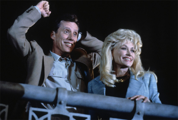 Dolly Parton and James Woods appear in a scene from the 1992 movie &#39;Small Talk.&#39; She plays a woman who ditches her small town life for Chicago, where she becomes a successful radio show host.  <span class=meta>(Hollywood Pictures &#47; Buena Vista Pictures)</span>
