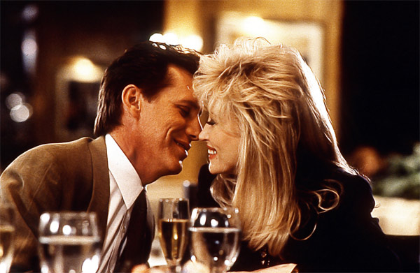 Dolly Parton and James Woods appear in a scene from the 1992 movie 'Small Talk.' She plays a woman who ditches her small town life for Chicago, where she becomes a successful radio show host.