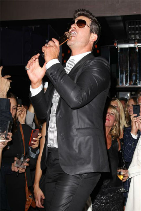 "<div class=""meta ""><span class=""caption-text "">Robin Thicke performs at a release party for his album 'Blurred Lines' held at the No. 8 nightclub in New York on Sept. 4, 2013. The event was hosted by Treats! magazine, which is celebrating its September 2013 issue, and presented by Ploom. (Kristina Bumphrey / Startraksphoto.com)</span></div>"
