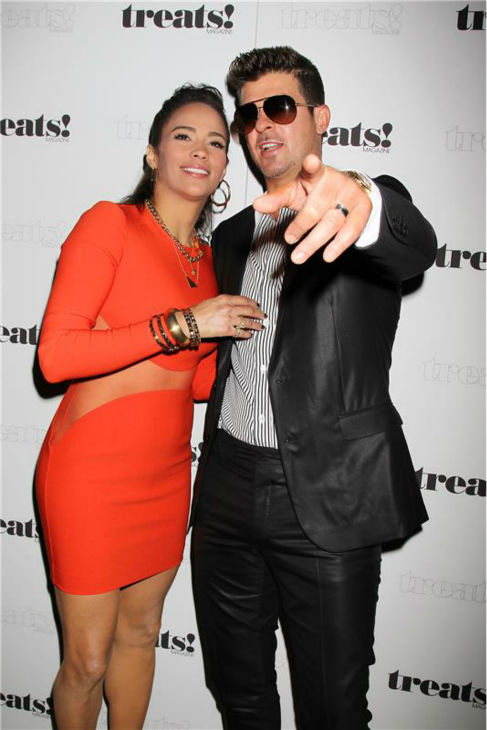 "<div class=""meta ""><span class=""caption-text "">Paula Patton and Robin Thicke appear at a release party for his album 'Blurred Lines' held at the No. 8 nightclub in New York on Sept. 4, 2013. The event was hosted by Treats! magazine, which is celebrating its September 2013 issue, and presented by Ploom. (Dave Allocca / Startraksphoto.com)</span></div>"