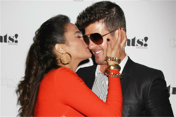 "<div class=""meta image-caption""><div class=""origin-logo origin-image ""><span></span></div><span class=""caption-text"">Paula Patton and Robin Thicke kiss at a release party for his album 'Blurred Lines' held at the No. 8 nightclub in New York on Sept. 4, 2013. The event was hosted by Treats! magazine, which is celebrating its September 2013 issue, and presented by Ploom. (Dave Allocca / Startraksphoto.com)</span></div>"
