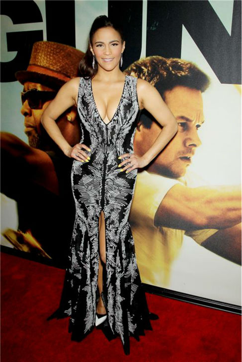 "<div class=""meta ""><span class=""caption-text "">Paula Patton attends the premiere of the film '2 Guns' at the SVA Theatre in New York on July 29, 2013. She is wearing a black and white Basil Soda gown with a plunging neckline and front slit from the designer's Fall/Winter 2013-2014 Ready-To-Wear collection. (Marion Curtis /  Startraksphoto.com)</span></div>"