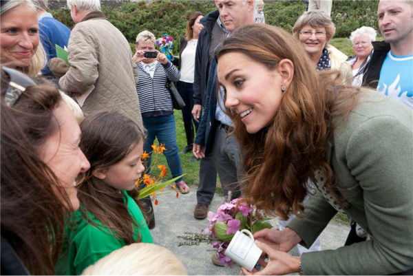Kate Middleton greets fans at the Ring O'Fire Anglesey Coastal Ultra Marathon in Anglesey in the United Kingdom on Aug. 30, 2013.