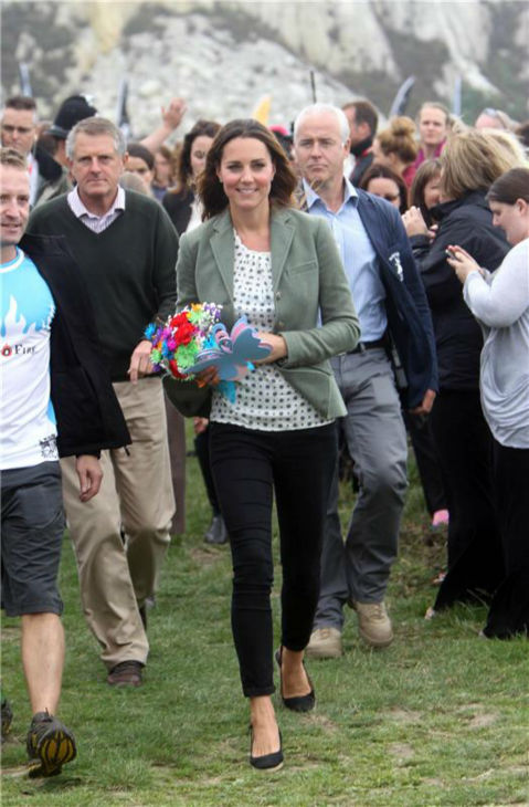 Kate Middleton greets fans at the Ring O&#39;Fire Anglesey Coastal Ultra Marathon in Anglesey in the United Kingdom on Aug. 30, 2013.  This marked her first official public appearance since she and husband Prince William welcomed their son, Prince George, who is their first child, on July 22. It came as a surprise to participants. Kate was originally scheduled to make her first public appearance on Sept. 12, at the Tusk Conservation Awards in London.  <span class=meta>(Barcroft Media &#47; Startraksphoto.com)</span>
