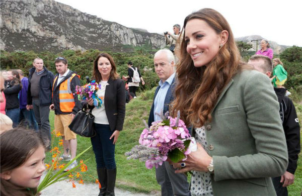 "<div class=""meta ""><span class=""caption-text "">Kate Middleton greets fans at the Ring O'Fire Anglesey Coastal Ultra Marathon in Anglesey in the United Kingdom on Aug. 30, 2013.  This marked her first official public appearance since she and husband Prince William welcomed their son, Prince George, who is their first child, on July 22. It came as a surprise to participants. Kate was originally scheduled to make her first public appearance on Sept. 12, at the Tusk Conservation Awards in London.  (Barcroft Media / Startraksphoto.com)</span></div>"