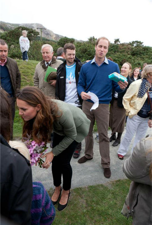 Kate Middleton and Prince William appear at the Ring O&#39;Fire Anglesey Coastal Ultra Marathon in Anglesey in the United Kingdom on Aug. 30, 2013. This marked the Duchess of Cambridge&#39;s first official public appearance since she and William welcomed their son, Prince George, who is their first child, on July 22. It came as a surprise to participants. Kate was originally scheduled to make her first public appearance on Sept. 12, at the Tusk Conservation Awards in London.  <span class=meta>(Barcroft Media &#47; Startraksphoto.com)</span>