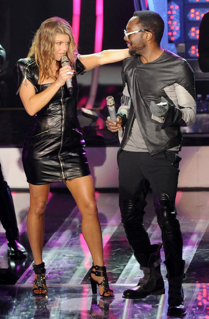 Fergie and will.i.am from the Black Eyed Peas perform at the MTV World Stage in New York City on April 18, 2011 to celebrate the arrival of the 21st Century Beetle.
