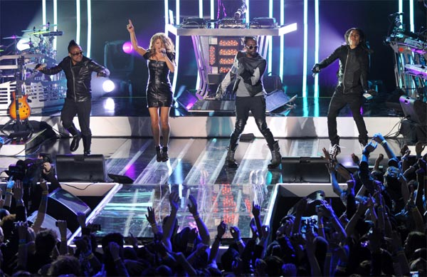 "<div class=""meta image-caption""><div class=""origin-logo origin-image ""><span></span></div><span class=""caption-text"">The Black Eyed Peas perform at the MTV World Stage in New York City on April 18, 2011 to celebrate the arrival of the 21st Century Beetle. (Scott Gries / PictureGroup)</span></div>"