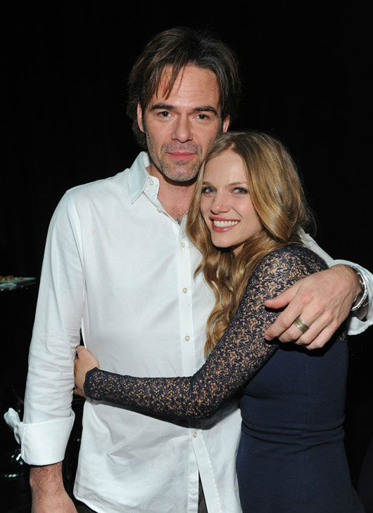 &#39;Revolution&#39; stars Billy Burke and Tracy Spiridakos share a hug at the Paley Center for Media&#39;s PaleyFest event honoring the NBC series, courtesy of Samsung Galaxy, at the Saban Theatre in Los Angeles on March 2, 2013. <span class=meta>(Kevin Parry for Paley Center for Media)</span>