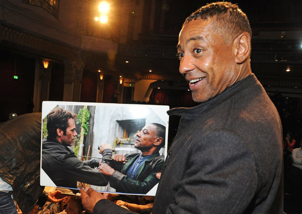 Actor Giancarlo Esposito shows off a still from the NBC series &#39;Revolution,&#39; which was honored at the Paley Center for Media&#39;s PaleyFest event, courtesy of Samsung Galaxy, at the Saban Theatre in Los Angeles on March 2, 2013. <span class=meta>(Kevin Parry for Paley Center for Media)</span>