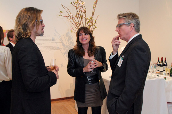 Brad Pitt (left) appears near LACMA curator and department head of Chinese and Korean Art, Stephen Little, as he presents significant works from LACMA's art collection on Wednesday, April 11, 2012.