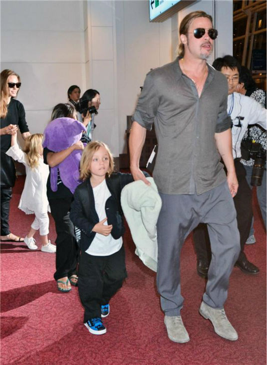 Angelina Jolie and Brad Pitt are seen at Tokyo International Airport on July 28, 2013 with three of their six children -- Pax, 9, and twins Knox and Vivienne, 5. <span class=meta>(Aflo &#47; startraksphoto.com)</span>