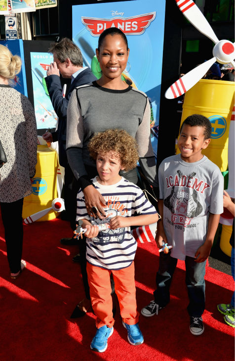 Actress Garcelle Beauvais and her sons Jaid Thomas and Oliver Saunders attend the premiere of Disney's 'Planes' film at the El Capitan Theatre in Hollywood, California on Aug. 5, 2013.