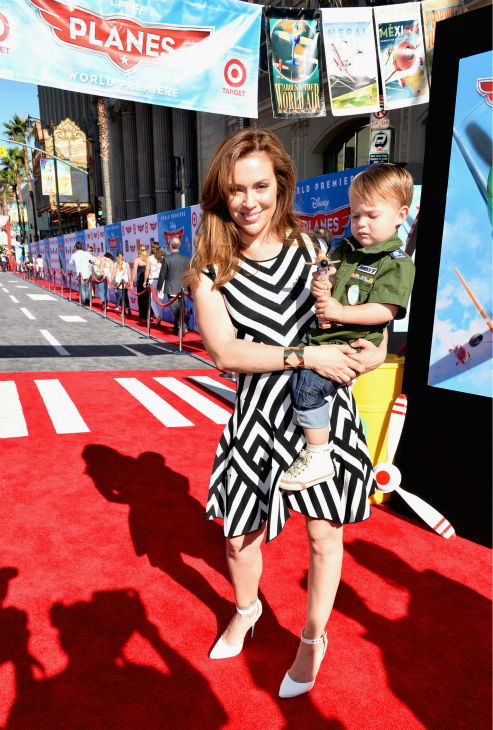 Alyssa Milano (L) and son Milo Bugliari attend the premiere of Disney's 'Planes' film at the El Capitan Theatre in Hollywood, California on Aug. 5, 2013.