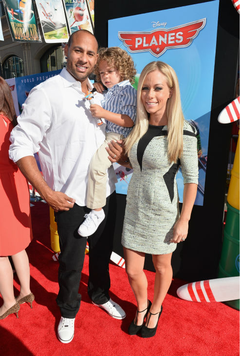 Kendra Wilkinson Baskett, husband and former NFL player Hank Baskett and son Hank Baskett IV attend the premiere of Disney's 'Planes' film at the El Capitan Theatre in Hollywood, California on Aug. 5, 2013.