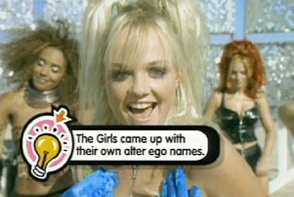 From left, Scary Spice, Baby Spice, and Ginger Spice of the Spice Girls with a caption listed from the show 'Pop Up Video.'