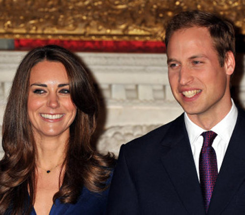 Prince William and Catherine Middleton hold a...