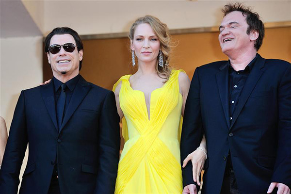 From left, John Travolta, Uma Thurman and director Quentin Tarantino arrive for the screening of &#39;Clouds of Sils Maria&#39; at the Cannes Film Festival in France on May 23, 2014. He directed them in &#39;Pulp Fiction,&#39; which marks its 20th anniversary in October. <span class=meta>(Aurore Marechal &#47; ABACA &#47; Startraksphoto.com)</span>