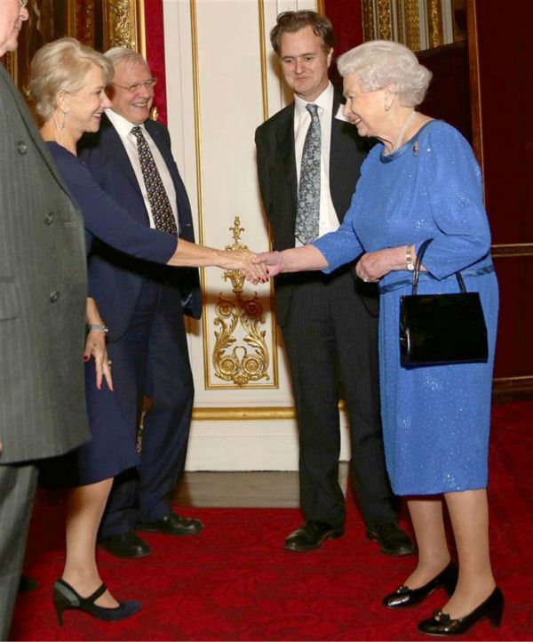 Helen Mirren shakes hands with Queen Elizabeth II at the Reception for the Dramatic Arts at Buckingham Palace on Feb. 17, 2014. The actress won an Oscar for playing the monarch in the 2006 movie &#39;The Queen.&#39; She also received an Emmy for her performance in the 2005 series &#39;Elizabeth I.&#39; <span class=meta>(Rex Features &#47; Startraksphoto.com)</span>