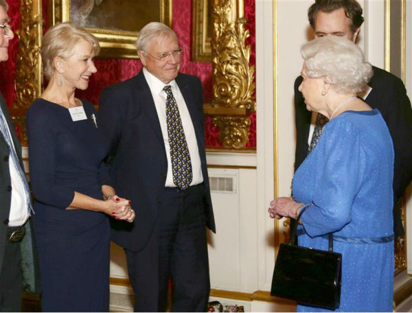 Dame Helen Mirren chats with Queen Elizabeth II at the Reception for the Dramatic Arts at Buckingham Palace on Feb. 17, 2014. The actress won an Oscar for playing the monarch in the 2006 movie &#39;The Queen.&#39; She also received an Emmy for her performance in the 2005 series &#39;Elizabeth I.&#39; <span class=meta>(Rex Features &#47; Startraksphoto.com)</span>