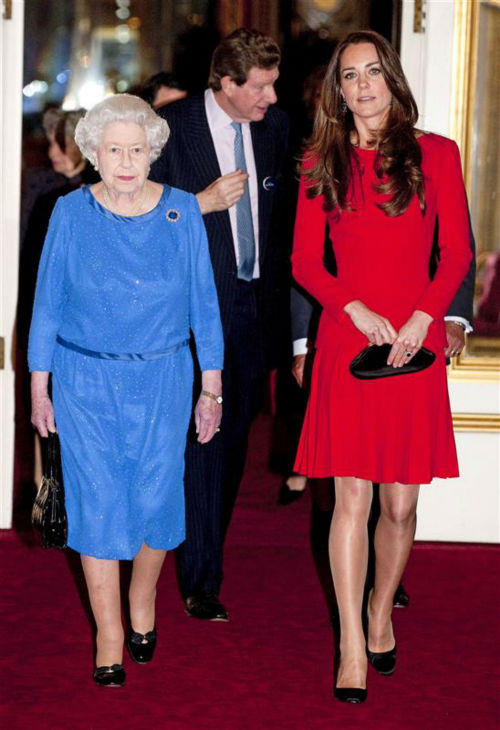 Kate Middleton, aka Kate, Duchess of Cambridge, walks with Queen Elizabeth II at the Reception for the Dramatic Arts at Buckingham Palace on Feb. 17, 2014. <span class=meta>(Rex Features &#47; Startraksphoto.com)</span>