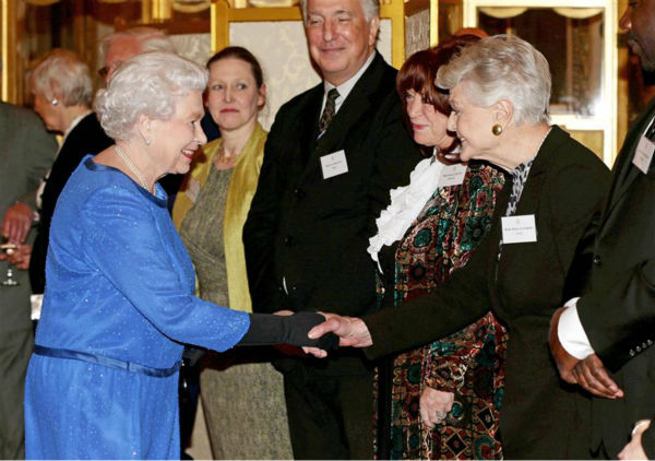 Dame Angela Lansbury &#40;&#39;Murder, She Wrote,&#39; &#39;Beauty and the Beast&#39;&#41; shakes hands with Queen Elizabeth II at the Reception for the Dramatic Arts at Buckingham Palace on Feb. 17, 2014. <span class=meta>(Rex Features &#47; Startraksphoto.com)</span>