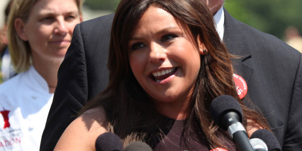 Rachael Ray appears in a photo speaking in favor of the Improving Nutrition for America's Children Act at a press conference in 2010.