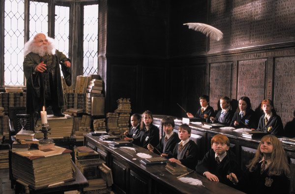 Harry Potter &#40;Daniel Radcliffe&#41; and his classmates appear in a scene from the 2001 film &#39;Harry Potter and the Sorcerer&#39;s Stone,&#39; also called &#39;Harry Potter and the Philosopher&#39;s Stone.&#39; <span class=meta>(Warner Bros. Pictures)</span>