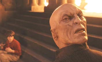 Harry Potter &#40;Daniel Radcliffe&#41; faces off against Voldemort for the first time in a scene from the 2001 film &#39;Harry Potter and the Sorcerer&#39;s Stone,&#39; also called &#39;Harry Potter and the Philosopher&#39;s Stone.&#39; <span class=meta>(Warner Bros. Pictures)</span>