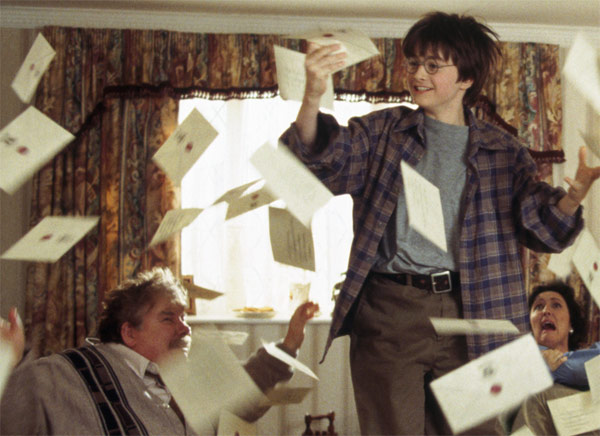 Harry Potter &#40;Daniel Radcliffe&#41; and his muggle family - Uncle Vernon &#40;Richard Griffiths&#41; and Aunt Petunia &#40;Fiona Shaw&#41; appear in a scene from the 2001 film &#39;Harry Potter and the Sorcerer&#39;s Stone,&#39; also called &#39;Harry Potter and the Philosopher&#39;s Stone.&#39; <span class=meta>(Warner Bros. Pictures)</span>