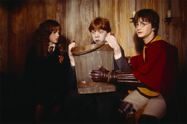 "<div class=""meta image-caption""><div class=""origin-logo origin-image ""><span></span></div><span class=""caption-text"">Hermione Granger (Emma Watson), Ron Weasley (Rupert Grint) and Harry Potter (Daniel Radcliffe) appear in a scene from the 2002 film 'Harry Potter and the Chamber of Secrets.' (Warner Bros. Pictures)</span></div>"