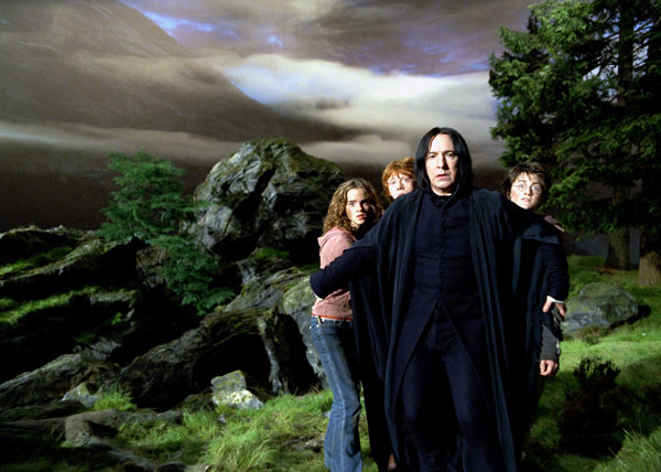 Hermione Granger (Emma Watson), Ron Weasley (Rupert Grint) and Harry Potter (Daniel Radcliffe) hide behind Professor Severus Snape (Alan Rickman) in a scene from the 2004 film 'Harry Potter and the Prisoner of Azkaban.'