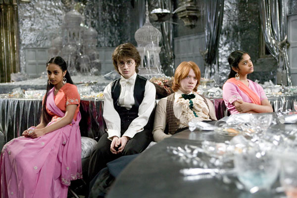 Harry Potter &#40;Daniel Radcliffe&#41; and Ron Weasley &#40;Rupert Grint&#41; and their dates to the Yule Balle - Padma Patil &#40;Afshan Azad&#41; and Parvati Patil &#40;Shefali Chowdhury&#41; appear in a scene from the 2005 film &#39;Harry Potter and the Goblet of Fire.&#39; <span class=meta>(Warner Bros. Pictures)</span>