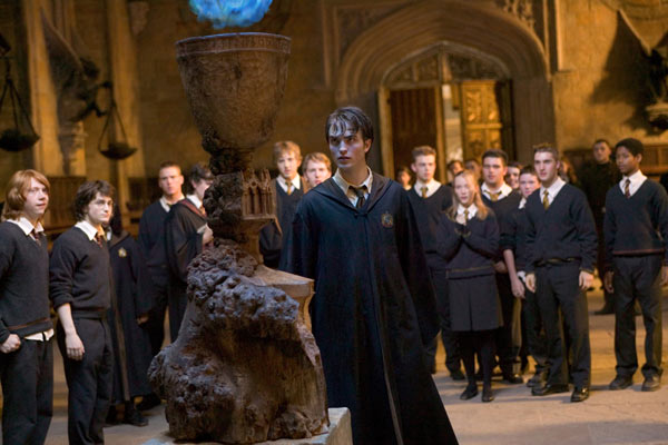 Ron Weasley &#40;Rupert Grint&#41;, Harry Potter &#40;Daniel Radcliffe&#41; and their classmates watch Cedric Diggory &#40;Robert Pattinson&#41; in a scene from the 2005 film &#39;Harry Potter and the Goblet of Fire.&#39; <span class=meta>(Warner Bros. Pictures)</span>