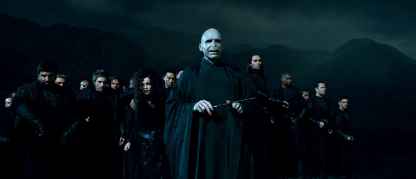 "<div class=""meta ""><span class=""caption-text "">The evil wizard Lord Voldemort (Ralph Fiennes) and his followers, or Death Eaters, appear in a scene from the 2011 film 'Harry Potter and the Deathly Hallows - Part 2.' (Warner Bros. Pictures)</span></div>"