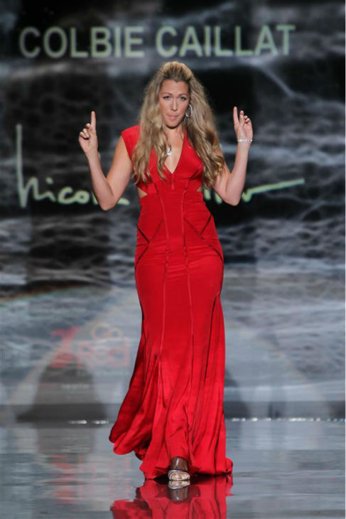 Pop star Colbie Caillat &#40;wearing Nicole Miller&#41; walks the runway at the Go Red For Women&#47;The Heart Truth Red Dress 2014 Collection fashion show during Mercedes-Benz Fashion Week in New York on Feb. 6, 2014. <span class=meta>(Amanda Schwab &#47; Startraksphoto.com)</span>