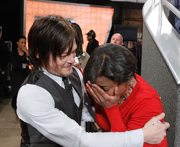 "<div class=""meta image-caption""><div class=""origin-logo origin-image ""><span></span></div><span class=""caption-text"">Norman Reedus, who plays Daryl Dixon on AMC's 'The Walking Dead,' comforts a crying fan on the set of the ABC show 'The View' on Nov. 26, 2013. (ABC / Lou Rocco)</span></div>"