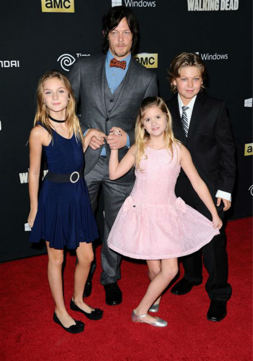 The time &#39;The Walking Dead&#39; star Norman Reedus &#40;Daryl&#41; was surrounded by adorable kids &#40;co-stars Brightton Sharbino &#40;Lizzie&#41; and Kyla Kenedy &#40;Mika&#41; and a guest&#41; at the red carpet premiere of the AMC show&#39;s season 4 at Universal Citywalk in Universal City, California on Oct. 3, 2013. <span class=meta>(Sara De Boer &#47; Startraksphoto.com)</span>