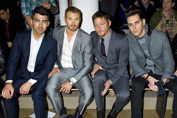 The &#39;Too-Much-Sexy-In-This-Room&#39; stare: Norman Reedus sits with Joe Jonas &#40;left&#41;, Kellan Lutz of &#39;Twilight&#39; fame and Cobra Starship singer Gabe Saporta at  Simon Spurr&#39;s Fall 2012 show during Mercedes-Benz Fashion Week in New York on Feb. 13, 2012. <span class=meta>(Justin Campbell &#47; Startraksphoto.com)</span>
