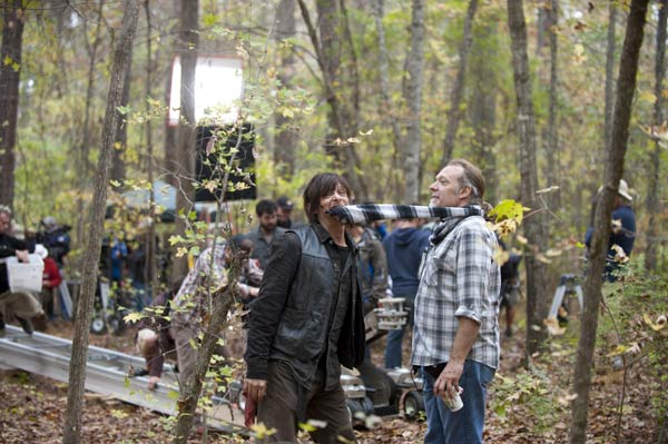 "<div class=""meta image-caption""><div class=""origin-logo origin-image ""><span></span></div><span class=""caption-text"">Norman Reedus (Daryl Dixon) and Co-Executive Producer/SFX Makeup Supervisor Greg Nicotero appear on the set of AMC's 'The Walking Dead' episode 15, 'Us,' which aired on March 23, 2014. (Gene Page / AMC)</span></div>"