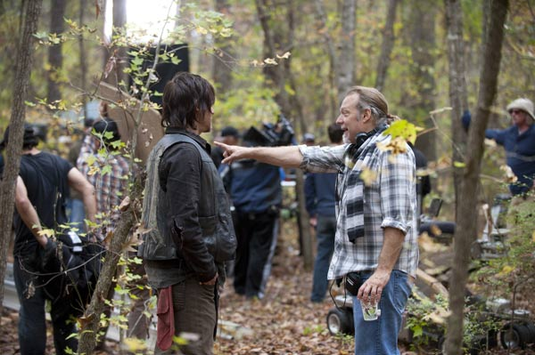 "<div class=""meta ""><span class=""caption-text "">Norman Reedus (Daryl Dixon) and Co-Executive Producer/SFX Makeup Supervisor Greg Nicotero appear on the set of AMC's 'The Walking Dead' episode 15, 'Us,' which aired on March 23, 2014. (Gene Page / AMC)</span></div>"