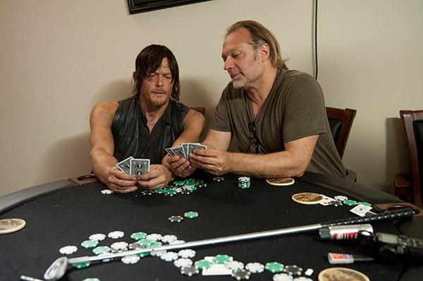 "<div class=""meta ""><span class=""caption-text "">Norman Reedus (Daryl Dixon) and Co-Executive Producer/SFX Makeup Supervisor Greg Nicotero play cards on the set of AMC's 'The Walking Dead' episode 12, 'Still,' which aired on March 2, 2014. (Gene Page / AMC)</span></div>"