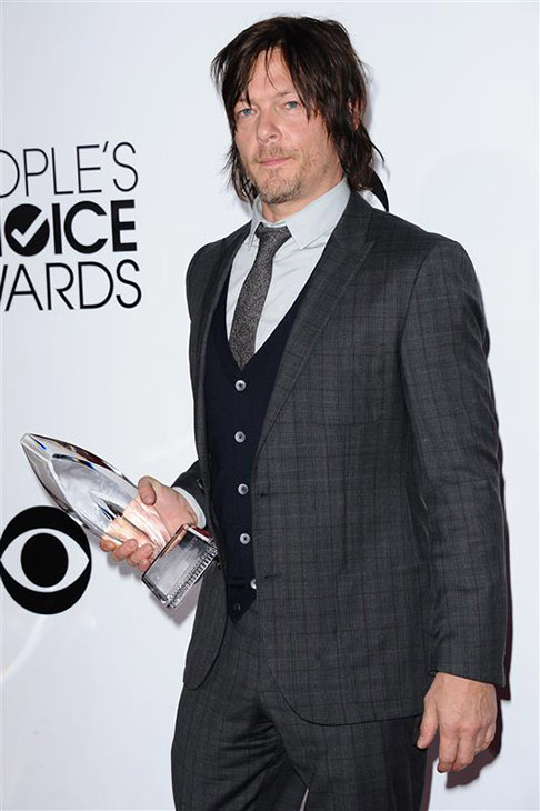 Norman Reedus, who plays Daryl Dixon on the AMC show 'The Walking Dead,' appears backstage with an award at the 2014 People's Choice Awards at the Nokia Theatre L.A. Live in Los Angeles on Jan. 8, 2014. The series won 2 awards.