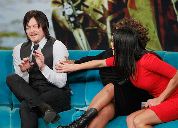 Norman Reedus, who plays Daryl Dixon on AMC&#39;s &#39;The Walking Dead,&#39; appears on the ABC show &#39;The View&#39; on Nov. 26, 2013. Co-host Sherri Shepherd and guest co-host Karla Martinez felt his bicep after he joked Dixon&#39;s muscles were the result of makeup. <span class=meta>(ABC &#47; Lou Rocco)</span>