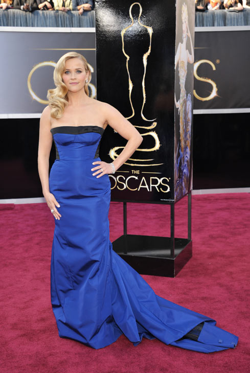 Reese Witherspoon arrives at the 85th Academy Awards at the Dolby Theatre on Sunday Feb. 24, 2013, in Los Angeles. The actress wore a cobalt Louis Vuitton strapless gown to the event. <span class=meta>(AP Photo&#47;John Shearer&#47;Invision)</span>